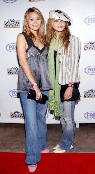 IRVINE, CA - JUNE 26:  Actors Mary-Kate and Ashley Olsen attend the grand opening of the Fox Sports Grill at the Irvine Spectrum on June 26, 2003 in Irvine, California.  The sports grill will open to the public on June 27, 2003.  (Photo by Frederick M. Brown/Getty Images)