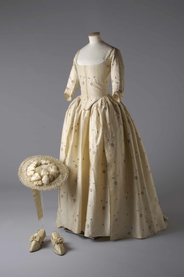 Silk brocade gown and petticoat, silk covered straw hat and silk satin shoes, 1780 Worn by Jane Bailey for her marriage to James Wickham. Photograph by John Chase.