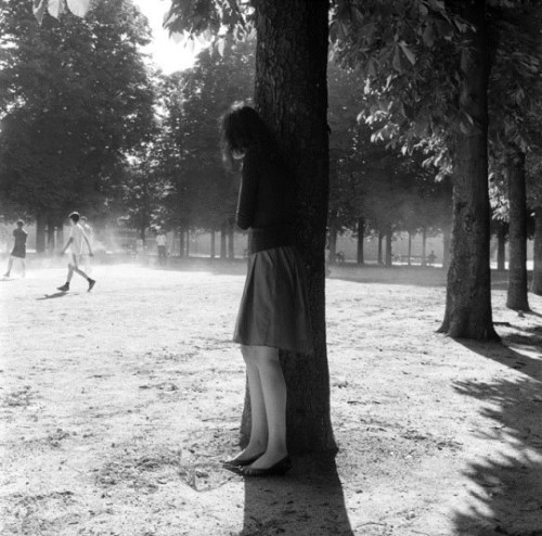 Woman-Hiding-Behind-Tree