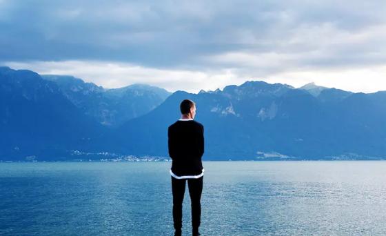 Man admiring a lake