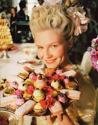Lady holding a tray full of sweet treats