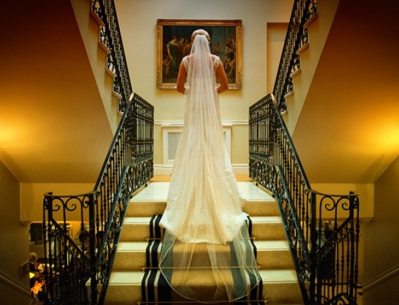 Bride on stairs at The Step House Hotel