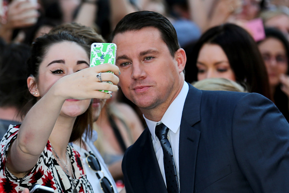 """LONDON, ENGLAND - JUNE 30: Actor Channing Tatum poses with a fan as he attends the European Premiere of """"Magic Mike XXL"""" at Vue West End on June 30, 2015 in London, England. (Photo by Tim P. Whitby/Getty Images)"""