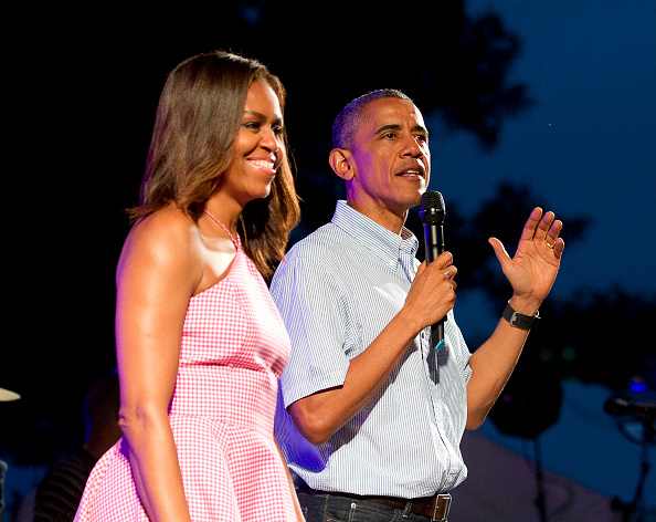 WASHINGTON, DC - JULY 04: U.S. President Barack Obama (R), accompanied by first lady Michelle Obama, gives remarks to members of the military and White House staff who were invited to the South Lawn of the White House on July 4, 2015 in Washington, DC. The guests were treated to a Bruno Mars concert and the traditional fireworks on the National Mall. An earlier Bar-B-Que had been planned but was cancelled due to inclement weather. (Photo by Ron Sachs - Pool/Getty Images)