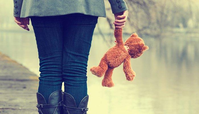 woman-holding-teddy-bear