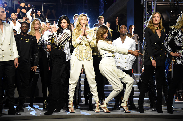 NEW YORK, NY - OCTOBER 20: Models Kendall Jenner, Gigi Hadid, and Jourdan Dunn pose on the runway with other models at the BALMAIN X H&M Collection Launch at 23 Wall Street on October 20, 2015 in New York City. (Photo by Nicholas Hunt/Getty Images for H&M)