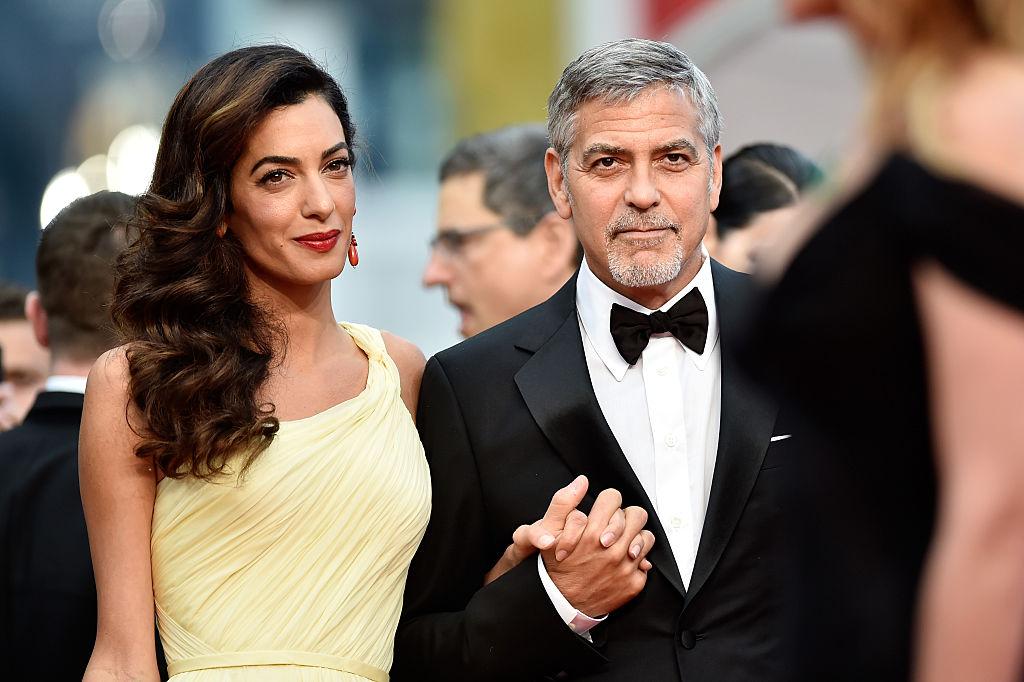"""CANNES, FRANCE - MAY 12:  Actor George Clooney and his wife Amal Clooney attend the """"Money Monster"""" premiere during the 69th annual Cannes Film Festival at the Palais des Festivals on May 12, 2016 in Cannes, France.  (Photo by Pascal Le Segretain/Getty Images)"""