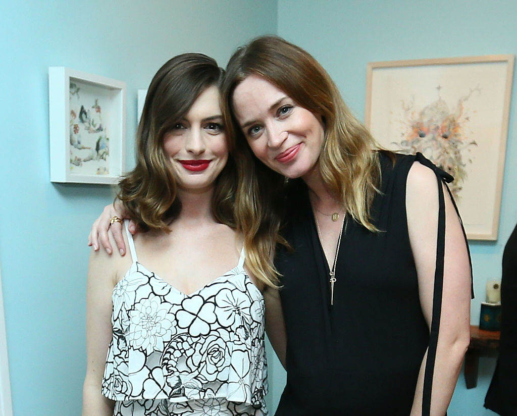 LOS ANGELES, CA - MAY 12:  Actress Anne Hathaway (L) and actress Emily Blunt attend Disney's Alice Through the Looking Glass event on May 12, 2016 at Roseark in Los Angeles California.  Top designers showcased whimsical fashions, accessories and beauty collections inspired by the upcoming film.  (Photo by Mark Davis/Getty Images for Disney Consumer Products & Interactive Media)